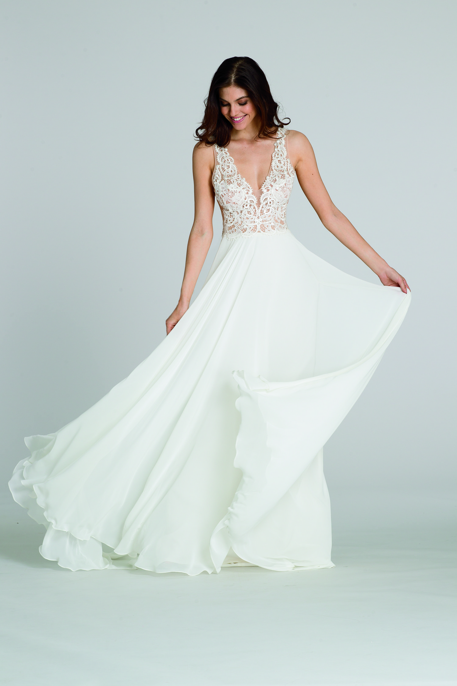 d056718a0a This bridal style will effortlessly twirl in the wind leaving your wedding  guests speechless!