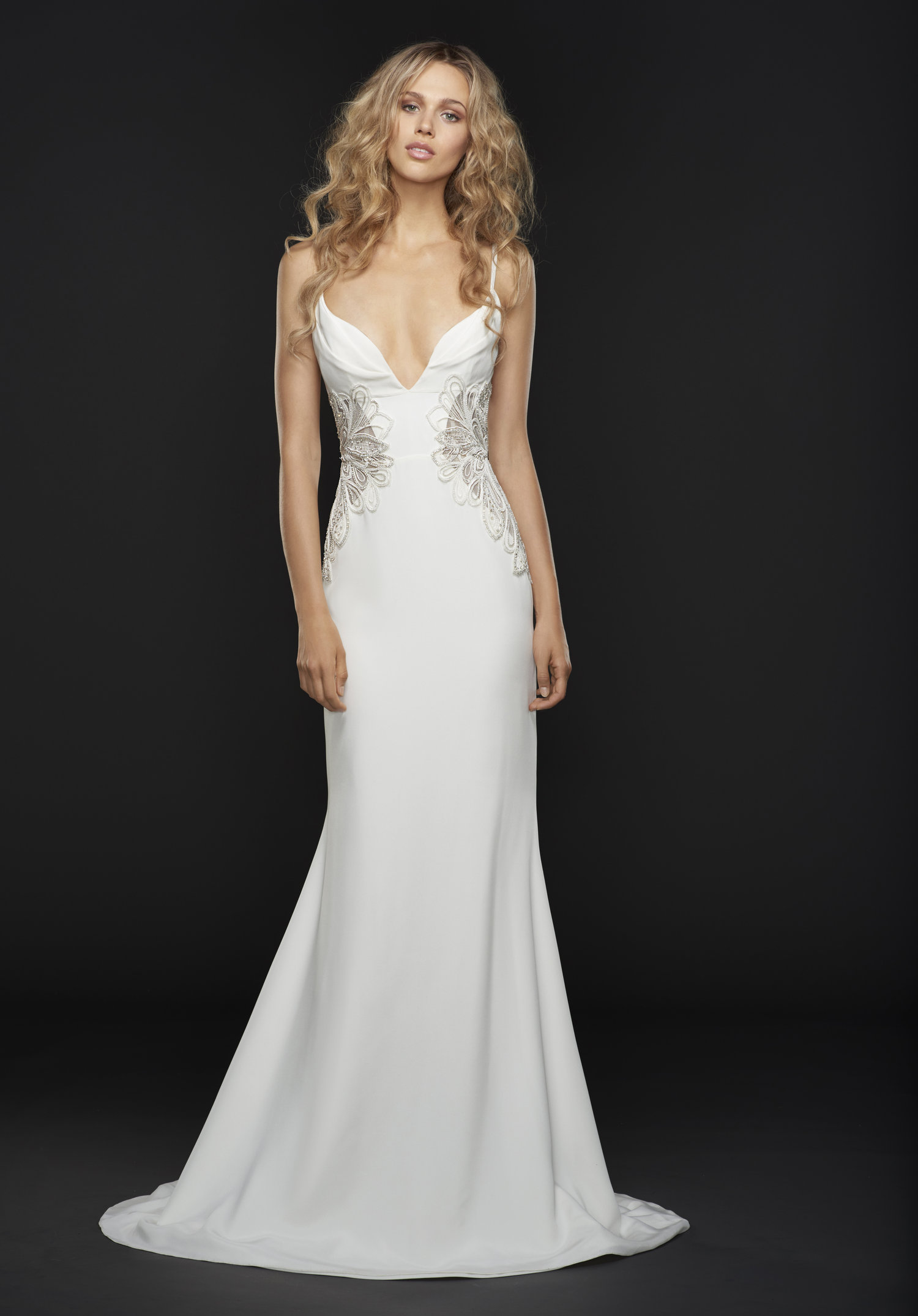ef1049e0cf The silk fabric and beautiful low-cut back of the Bryn wedding dress will  illuminate under the sun while you say