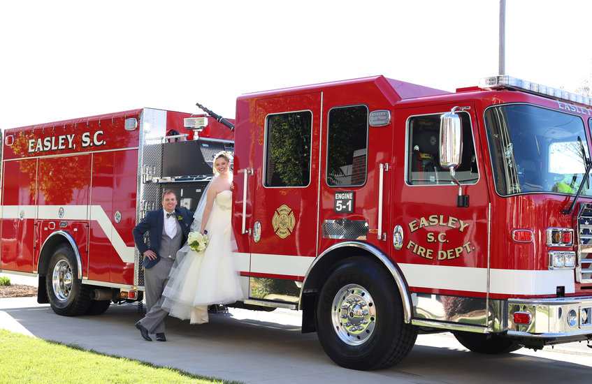 bride and groom on fire truck