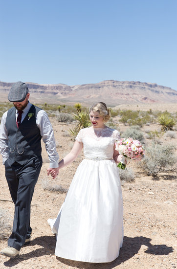 bride and groom in the dessert