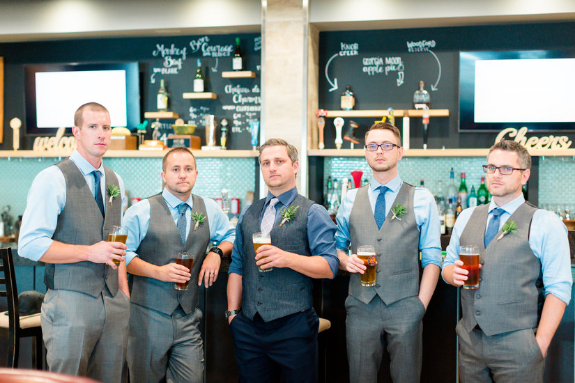 Groomsmen having beers before the ceremony