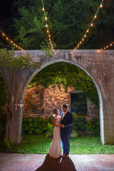 Bride and groom at night at The Old Mill