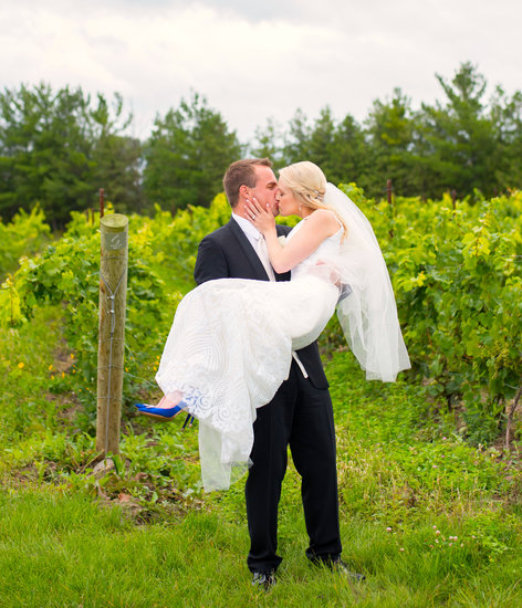 Bride & Groom kiss in the vineyard