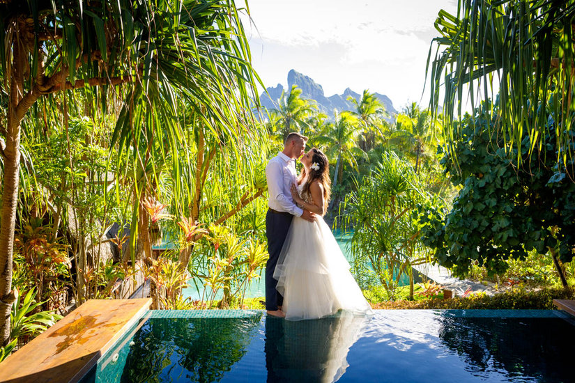 Bride and groom kissing in the gardens at the spa at the Four Seasons Bora Bora
