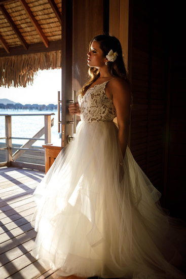 Bride posing in the overwater bungalow