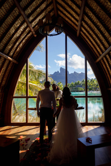 Bride and groom eloping in the chapel at the Four Seasons Bora Bora