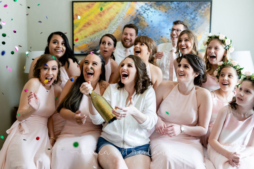 Bridal party surprised by confetti