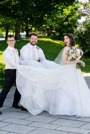 Bride's dress held by brides-men