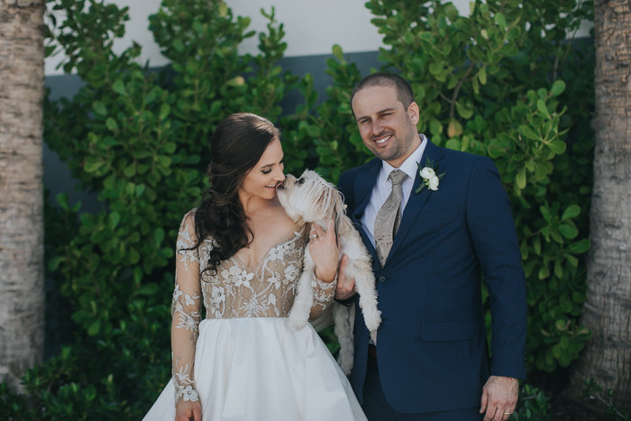 Bride and puppy kisses!