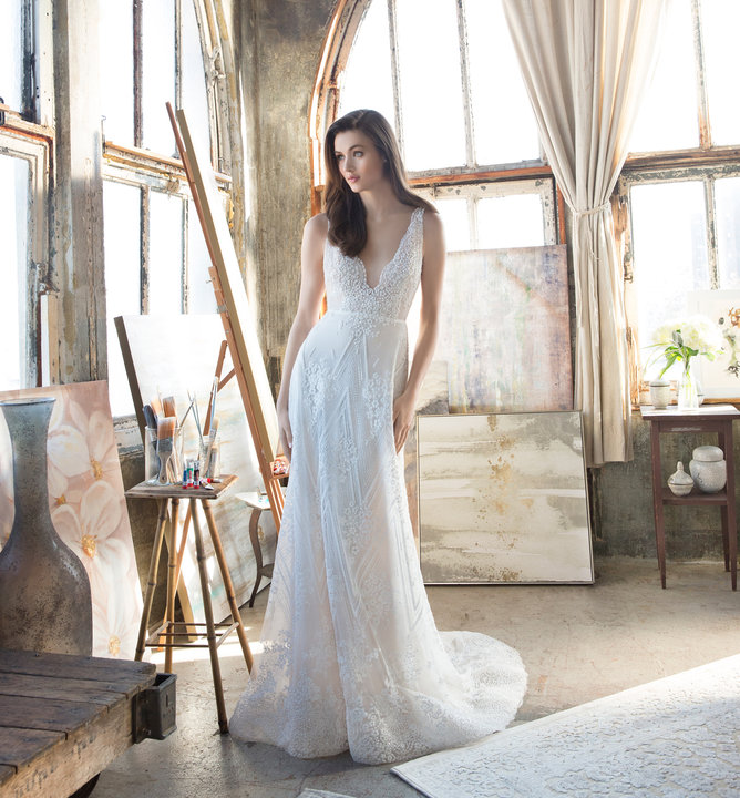 Style 2810 Tara Keely by Lazaro bridal gown - Ivory beaded floral and chevron modified A-line bridal gown, illusion V neckline, open back with dual crystal straps and chapel train.